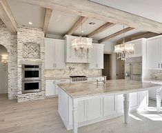 Love the combination of materials in this kitchen. The exposed brick and chandeliers make for a perfect rustic glam look.… the home Home Decor Kitchen, House Design, Home, Kitchen Remodel, Home Remodeling, House Interior, Home Renovation, Home Kitchens, Kitchen Design