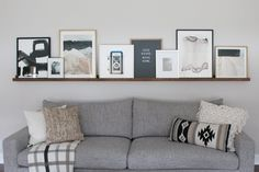 DIY Picture Ledge Over the Couch Filled with Art. This DIY picture ledge is full of art pieces from Minted. A DIY Picture Ledge is a perfect option to display assorted art. Get the details on how you can make a DIY Picture Ledge for your space! New Living Room, Home And Living, Living Room Decor, Gallery Wall Living Room Couch, Living Room Wall Decor Ideas Above Couch, Shelves Over Couch, Over Couch Decor, Art Over Couch, Diy Home Decor Rustic