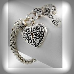 Silver and black heart lock and key bracelet. Heart Jewelry, Jewelry Bracelets, Jewelery, Silver Jewelry, Fine Jewelry, Geek Jewelry, Silver Pendants, Gothic Jewelry, Silver Earrings