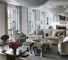 Monochromatic Silver Living Room With Large Chandelier