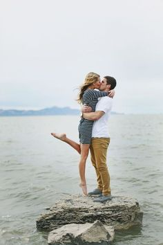 Engaged - Couple shot on rock by water - beach photos - great pose - passionate