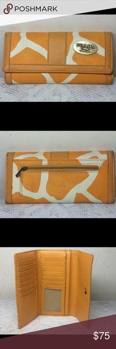 1d1d7b5865f9 Shop Women s Prada Milano Orange Cream size Tri-Folded Wallets at a  discounted price at Poshmark. Description  Excellent Used Condition