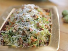 Shaved Brussels Sprouts with Walnuts and Pecorino recipe from Guy Fieri via Food Network