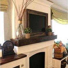 Framing In a Wall Mount Television {Home Decor DIY} Televisions can be a bit of a necessary eye sore, but with this tutorial you can dress it up a bit! Using some wood and a few power tools you'll be able to take that TV from an eye sore to a piece of stylish home decor with not a lot of expense!