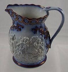 Flow blue copper luster relief molded jug    Full-size image