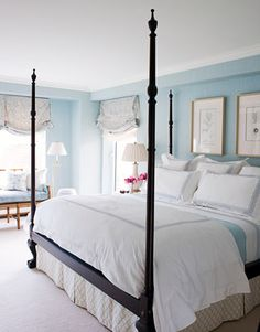 "The master bedroom is ""soft without being too feminine,"" Whittaker says. She balanced the weight of the reproduction four-poster bed from the Federalist with silk wallcovering from Rogers & Goffigon and print curtain fabric from Holland & Sherry that is ""pretty, but not girly."" Matouk bedding. Ceramic table lamp, Williams-Sonoma Home.   - HouseBeautiful.com"