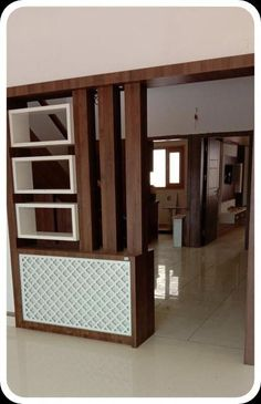 Simple and functional in a small living room a wooden partition design more then glass slaves also presents display space for books and accessories Room Partition Wall, Living Room Partition Design, Pooja Room Door Design, Living Room Tv Unit Designs, Room Partition Designs, Ceiling Design Living Room, Kitchen Room Design, Home Room Design, Home Interior Design
