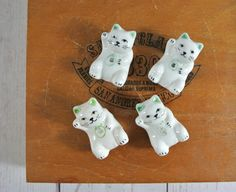Vintage Set of 4 Ceramic Lucky Cat Chopstick Rests | Chopstick Holders by greenkittenvintage on Etsy https://www.etsy.com/listing/272911766/vintage-set-of-4-ceramic-lucky-cat