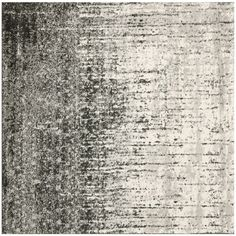 Perfect for giving your living space a retro feel with a contemporary twist, this Safavieh square rug displays a stunning black-and-gray abstract design. This area rug was made from soft polypropylene for a pampering walking experience.