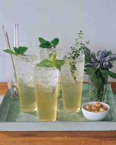 Don't let an abundance of herbs go to waste. Pluck several types of sprigs -- we used basil, mint, and thyme -- and use them to flavor a basic sugar syrup. Mix the concoction with ice and sparkling water, then garnish the drinks with additional sprigs.
