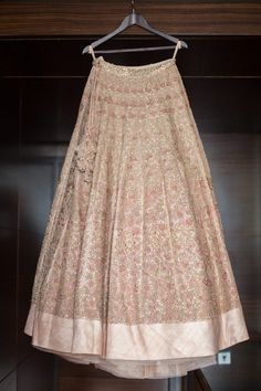 Pastel pink wedding lehenga embellished with embroidery motifs and matching latkans by Shymmal and Bhumika.| weddingz.in | India's Largest Wedding Company | Wedding Venues, Vendors and Inspiration | Designer Bridal Lehenga |