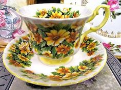ROYAL ALBERT TEA CUP AND SAUCER MARGUERITE YELLOW PATTERN TEACUP