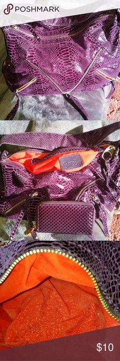 Carlos by Carlos Santana Shoulder Bag Purple snakeskin embossed leather with 3 zippers in front. Inside is red and the only flaws are little white strains on the bottom lining inside the purse. The wallet is included in price. Both lightly used. Carlos Santana Bags Shoulder Bags