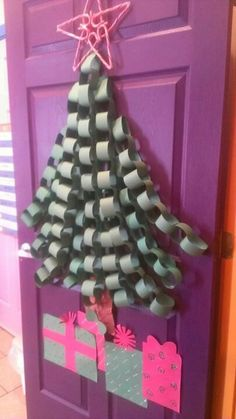 Easy holiday door decor for the classroom. The star is made out of candycanes!