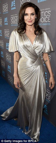 Pale and beyond: Angelina Jolie and Rosamund Pike carried on the pale and lovely awards se...