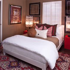 Master Bedroom with #Red #Nightstands - Designed by Elizabeth Gordon. An eclectic mix of textures and colors creates the perfect balance for this master #bedroom.