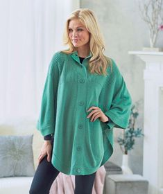 Women's Button Neck Sweater Poncho is a versatile piece that can be worn as a poncho or a dolman-sleeved sweater. It has decorative button details on the sleeves. Cable knit neck and shoulders add to its stylish appearance. Slip it on and it will ins