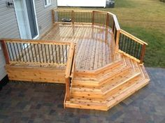 Wooden deck with two little stairs from both doors meeting main level. This would mean taking out the brick stairs. Description of this deck: cedar deck with corner wrap around steps. Corner Deck, Side Deck, Front Deck, Deck Ideas For Small Houses, Narrow Deck Ideas, Back Deck Ideas, Small Decks, Porch Ideas, Patio Ideas