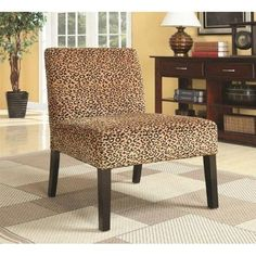 Accent Seating Accent Chair w/ Wood Legs, Coaster 900184  Provide a modern sensibility into your #living #room #decor with this #accent #chair. The piece carries either a square spiral or leopard pattern and features square tapered legs for a beautiful contrasting appearance. You'll be set with this accent chair in your home.
