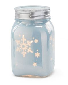 Mason Jar warmer!  Love the beautiful snowflakes that lets light shine through. Scentsy has winter covered!