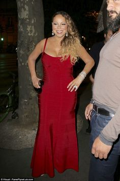 Finishing touches: Mariah added plenty of glitzy jewellery to her look and styled her hair to the side
