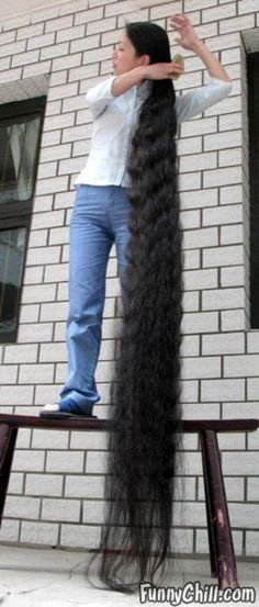 This is crazy insane! Can you imagine how long it takes to take care of it? It's longer than she is tall!