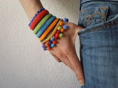 Cronian ... Freeform Crochet Cuff - Red Green Orange Blue Indigo - Rainbow - Beaded Beadwork