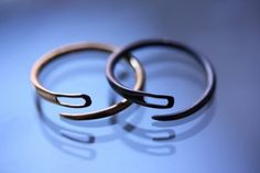 Hand made Gold and oxidised silver needle rings by Alice O'Neill.