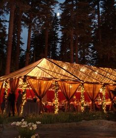 Clear tent with lights for outdoor reception ... beautiful! Shop all string lights online at www.partylights.com!