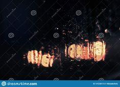 Raindrops on the window.. Photo about winter, nights, storm, bokeh, moisture, rains, window, rain, windows, raindrops, droplets, drop, stormy, blurred, romantic, wind - 141230113