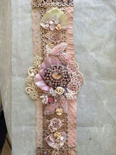 I love pastel colors. Light pink and salmon are my favorites. This snippet roll, with lace, beads, and very delicate embellishments is certainly of my taste. Shining brooch in the centre attracts the attention from the first moment Fabric Bracelets, Lace Bracelet, Bracelet Cuir, Handmade Bracelets, Handmade Jewelry, Cuff Bracelets, Lace Jewelry, Textile Jewelry, Fabric Jewelry