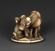 Ivory Dog and pup on a round base, attributed to Masanao of Kyoto, 18th century