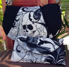 Black and White Goth, Antique, Skull and Dagger ROSIE Cross Body Purse with Wallet This cross body style bag is a comfortable, effortless, casual style. This bag will accommodate all of your belongings without getting in the way. A great bag for all ages. A long, adjustable strap is included. This particular fabric provides LOTS of options to combine to make a wonderfully unique product.