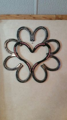 Handmade and hand painted horseshoe heart wreath. Made for my mother c going through breast cancer again.