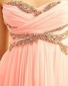 Coral-colored formal dress w/sequins around neckline area.