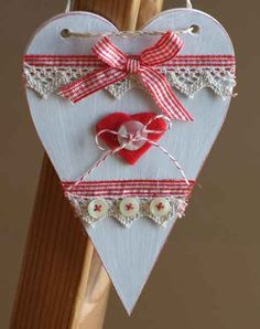 Handmade Wall Decorations gift idea by Janys Hyde found on MyOwnCreation: Pretty wooden heart painted white and then embellished with cru coloured lace, red and white Vichy check ribbon, buttons and butchers string. Natural string threaded through holes at the top of the heart for hanging. The outer edges of the heart have been lightly distressed in red.