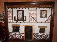 Cuadro en relieve de una fachada de estilo rústico
