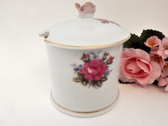 Beautiful porcelain covered dish for sugar, jam, sauce or other condiments.  Lid has lifting knob and spoon slot  Wild rose transfers with hand painted gold trim on bowl sides and lid  Charming pink and gold porcelain rose lid knob 1960's tableware, ...