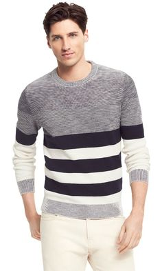 Tommy Hilfiger men's sweater. A few well-placed stripes give the illusion you've spent hours at the gym rather than team bonding at happy hour (we won't tell). Besides making you look good, this sweater feels great in premium cotton that fits snug where it you need it, looser where you don't.