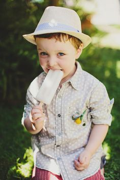 precious ring bearer with ice lolly // photo by Jonathan Ong