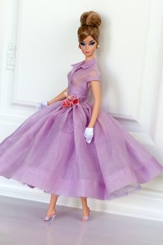 Barbie with a perfect purple dress. Model and Earrings: IDC Milan Boater Silkstone Barbie. Gown: Bogue's Vogues.  Gloves and Shoes: Mattel.