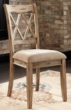 With the variety of finishes beautifully adorning the rich rustic design of each piece the Mestler Antique White Upholstered Side Chair Set of 2 from Ashley takes Vintage Casual and offers an array of furniture to suit the needs of any dining room decor. With finishes ranging from rich brown to textured honey pine along with the antique blue finish hard seat chair to the beautifully tufted fully upholstery chair this collection is sure to have whatever you desire.