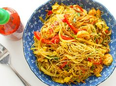 Singapore Noodles - It's not entirely clear where Singapore noodles—the stir-fried curried rice noodles with shrimp, pork, and vegetables—come from, though it's unlikely Singapore is the source. Regardless, they're a stir-fry classic, and are easy to make at home. Here's what you need to know, from how to choose the right rice noodles to how to make the stir-fry work on a home burner.