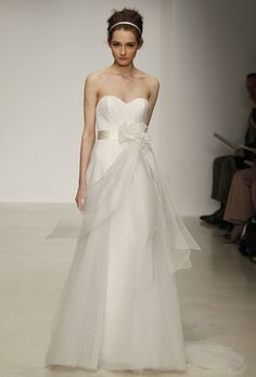 "Brides: Christos - Spring 2013. ""Charlotte"" strapless tulle ball gown wedding dress with a cascading silk organza sash and floral detail at the waist, Christos"