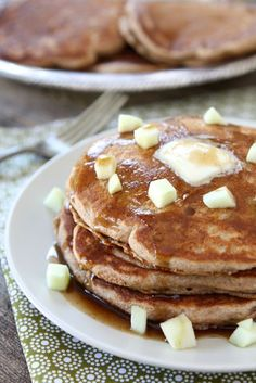 Whole Wheat Apple Cinnamon Pancakes with Cinnamon Syrup from Two Peas and Their Pod.  Note: Uses whole wheat flour and buttermilk.