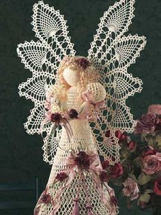 Heavenly Pineapple Angel I -Grace your home with this beautiful 3-foot-tall crocheted angel. Crocheted with size 10 crochet cotton and a size 5 steel crochet hook, and embellished with silk roses, satin ribbon and tassels, her majestic stature and timeless elegance inspire awe in all who see her. Skill Level: Intermediate  free pdf from freepatterns.com  I like angels at any time of the year.