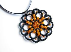 Delicate black pendant with orange glass beads. Round rosette motive is of hand made tatted lace. I used my own original pattern. Pendant…