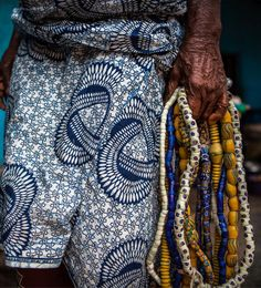 Africa   Woman holding stands of necklace ~ a combination of old trade beads and contemporary Krobo glass beads.  Photo taken during the Dipo ceremony.  Southern Eastern region, Ghana   ©Anthony Pappone.