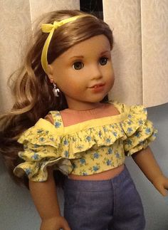Soft yellow and denim blue: perfect for Summer — and for American Girl GOTY Lea Clark. Agundone of AmericanGirlPlaythings made the perfect Summer vacation top for her American Girl doll using Lee & Pearl's 2016 FREE pattern for mailing list subscribers. Get your own copy of Lee & Pearl Pattern 1035: Olá Brasil Samba Top, Bahia Dress, Baiana Headwrap and Jewelry Tutorials for 18 Inch Dolls by signing up today at www.leeandpearl.com
