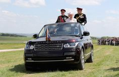 Queen Elizabeth Driving In Her Land Rover See More II Photos